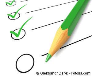 Checkliste mit einem grünen Stift